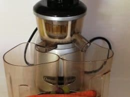 image of Omega VRT350S Juicer and a bowl of fruit and vegetables