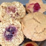image of peanut butter and jelly muffins - one cut open and one whole
