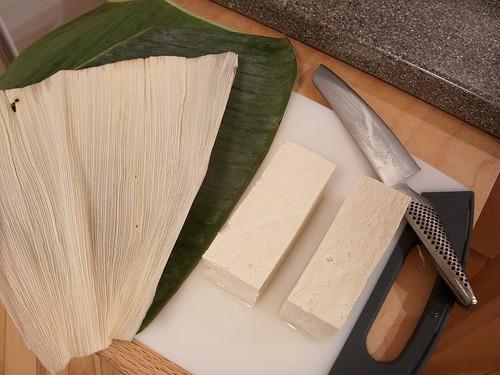 a block of tofu being prepared