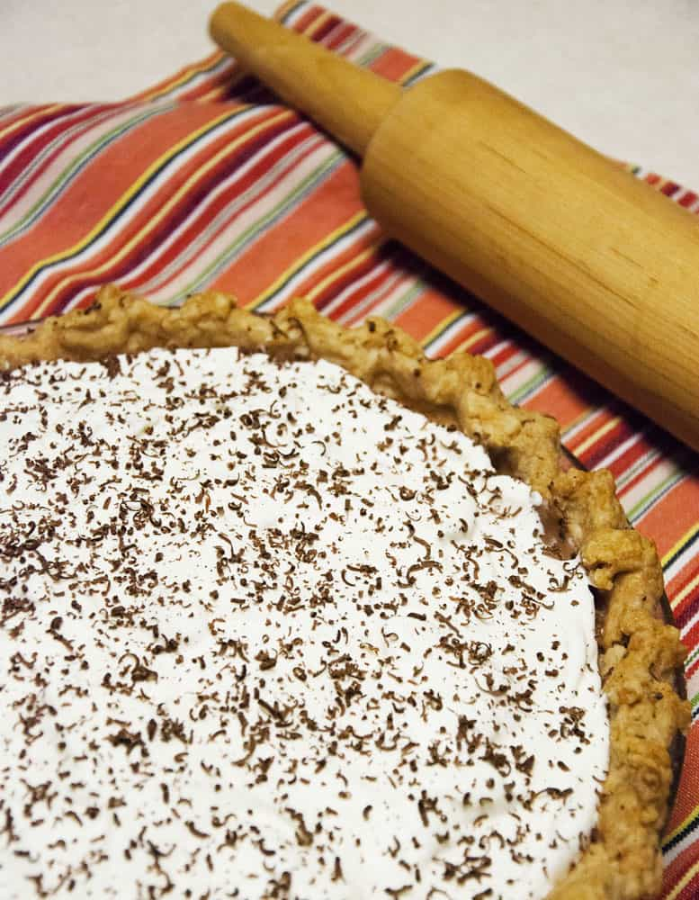 pie and rolling pin on a placemat