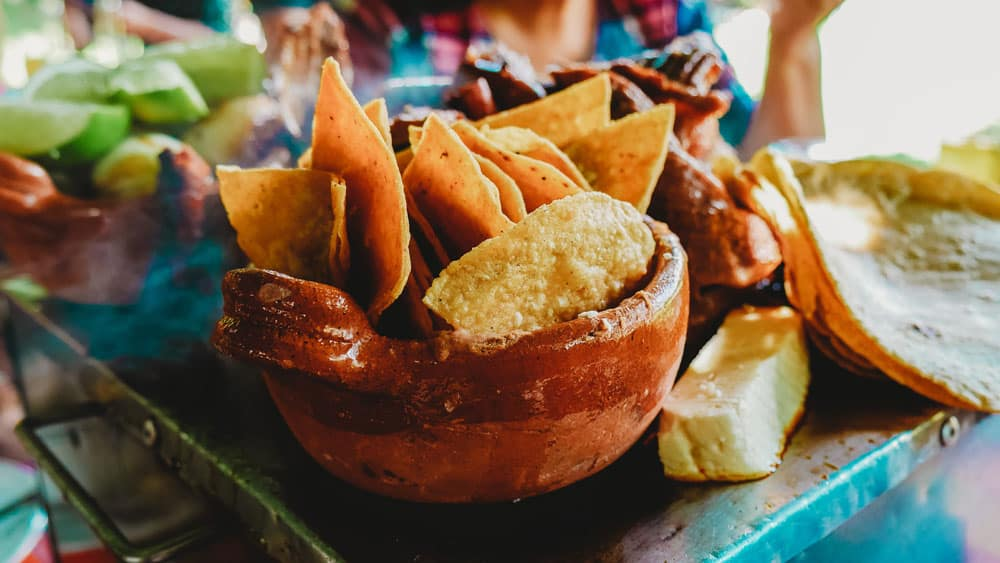 bowl of chili-lime tortilla chips on a table