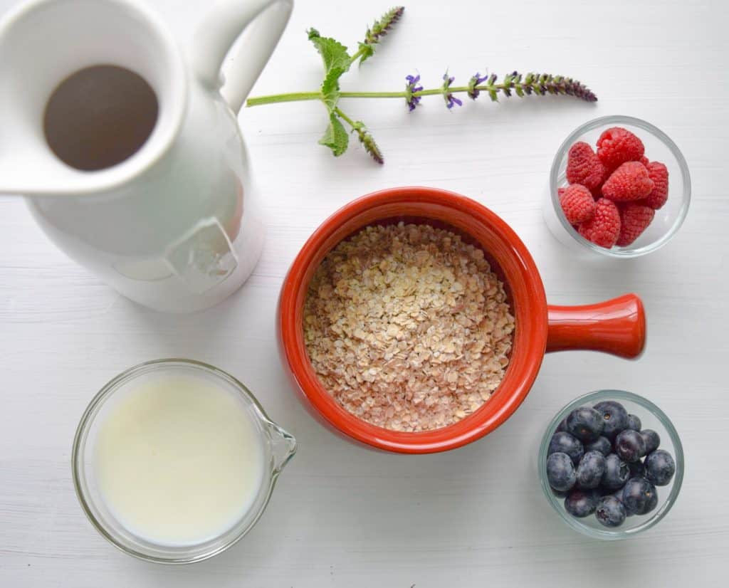 bowl of cereal near white pitcher